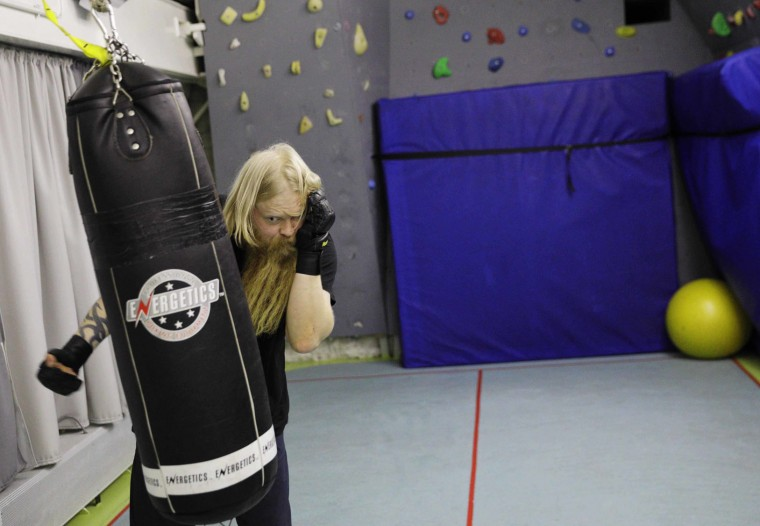In this Tuesday, July 18, 2017 photo, trainee Jussi Mikkotervo works out on a punching bag aboard the Finnish icebreaker MSV Nordica as it sails the Beaufort Sea to traverse the Northwest Passage through the Canadian Arctic Archipelago. (AP Photo/David Goldman)In this Tuesday, July 18, 2017 photo, trainee Jussi Mikkotervo works out on a punching bag aboard the Finnish icebreaker MSV Nordica as it sails the Beaufort Sea to traverse the Northwest Passage through the Canadian Arctic Archipelago. (AP Photo/David Goldman)