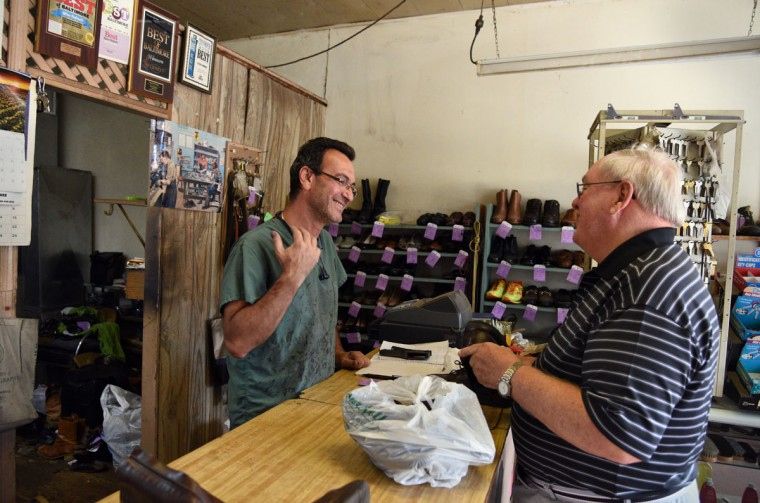 Eugene Gomberg, left, chats with regular customer Jim Williams, right of Baltimore, at the counter. Mr. Gomberg owns ESG Shoe Repair in Roland Park and has been a cobbler for 25 years. He has been awarded Baltimore's Best cobbler many times over the years. (Barbara Haddock Taylor/ Baltimore Sun)