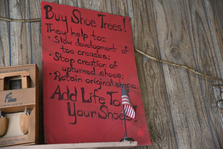 A sign at ESG Shoe Repair encourages customers to buy shoe trees. (Barbara Haddock Taylor/ Baltimore Sun)