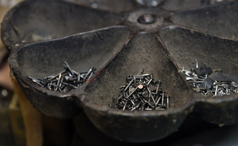 Shoe nails are in a metal dish at ESG Shoe Repair. (Barbara Haddock Taylor/ Baltimore Sun)