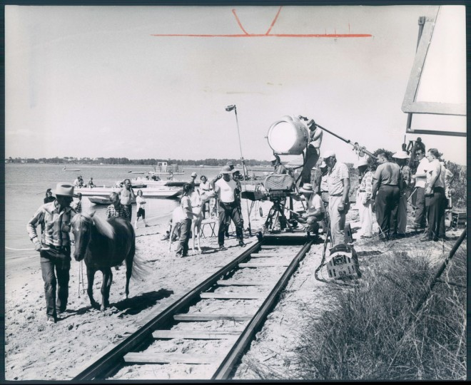 November 6, 1960 - CHINCOTEAGUE'S PONIES IN A MOVIE -- Filming a scene on the beach. Only the principals were professional actors. Chincoteague and Accomac people were hired for other roles. Photo taken by Baltimore Sun Staff Photographer A. Aubrey Bodine.