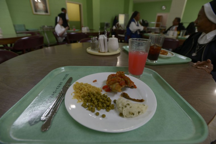 Dinner at the motherhouse is simple and satisfying: chicken, mashed potato and vegetables. (Christina Tkacik/Baltimore Sun)