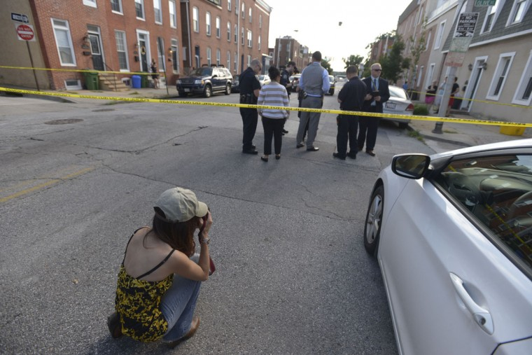 """Ybarra said she approaches crime scene photography from the perspective of an artist, rather than a journalist. """"I think there's this weird intersection of the things that scare you, the things that are dark and the things that are beautiful and that's what I'm looking at,"""" she said. (Christina Tkacik/Baltimore Sun)"""