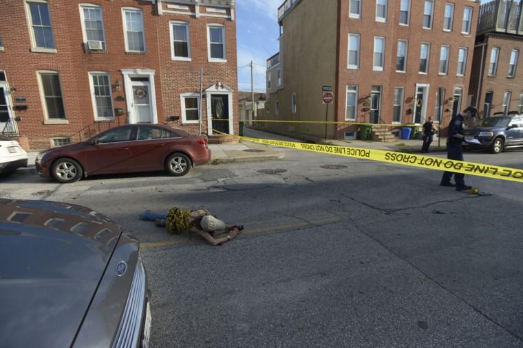 Ybarra isn't afraid to get on the ground at a scene to get the perfect shot. (Christina Tkacik/Baltimore Sun)