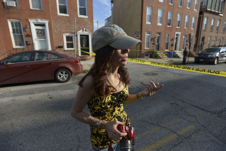 """Ybarra thinks her presence at crime scenes helps hold police and local news stations accountable. """"Every life counts, and it gets rolled up into two to four lines in a Baltimore police press statement. And I hate to see that,"""" she said. (Christina Tkacik/Baltimore Sun)"""