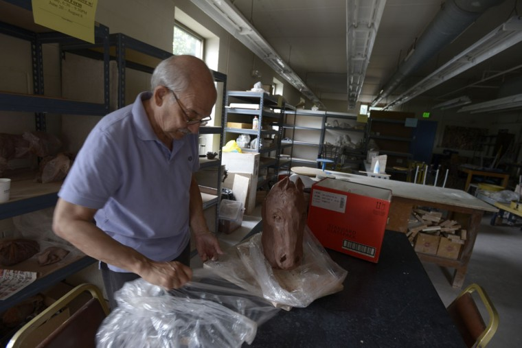 "Eric Fine examines a horse head that he had been working on in a class at Clayworks. ""You can see a lot more has to be done,"" he said. But Clayworks closed last week -- and Fine's course won't finish. (Christina Tkacik/Baltimore Sun)"