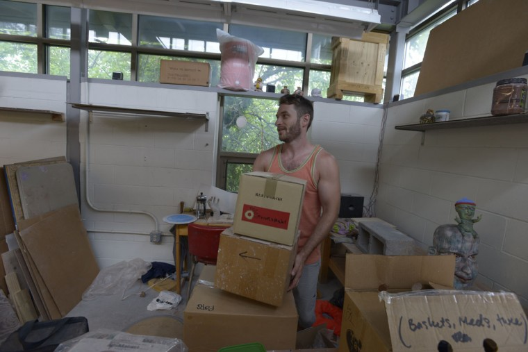 "Artist and teacher Kevin Rohde packs up some of his belongings from Clayworks. ""There's so many people being displaced by this,"" he said. (Christina Tkacik/Baltimore Sun)"
