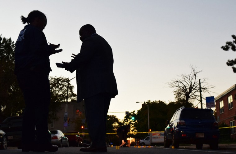 """""""Detectives investigate an October 2016 shooting on McCulloh Street."""" (Photo and caption courtesy of Maggie Ybarra)"""