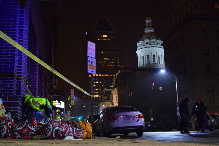 """""""Crime lab technicians collect evidence of a December 2016 shooting that took place near the intersection of E. Saratoga Street and Holliday Street."""" (Photo and caption courtesy of Maggie Ybarra)"""