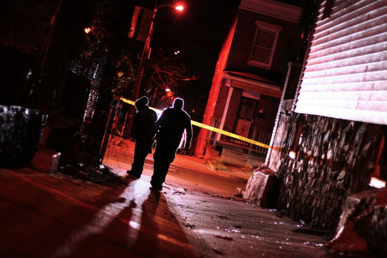 """""""Police investigate a December 2014 shooting in the 500 block of Edgewood Street."""" (Photo and caption courtesy of Maggie Ybarra)"""
