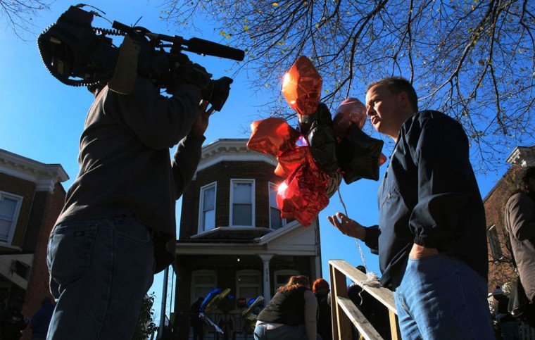 """""""Baltimore Police Commissioner Kevin Davis talks to local media about why it was important for police to pitch in and finish building Kendal Fenwick's fence. Police and the community gathered at Fenwick's house on November 15, 2015, a few days after Fenwick was murdered."""" (Photo and caption courtesy of Maggie Ybarra)"""