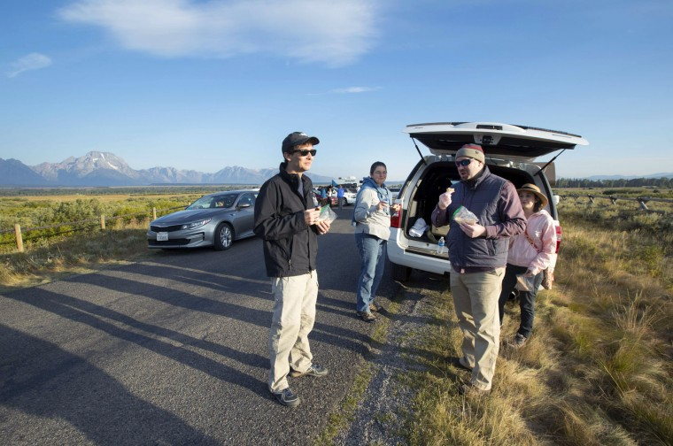 The Clark family, from Shreveport, Louisiana has breakfast as they wait for the total eclipse in Grand Teton National Park on August 21, 2017 outside Jackson, Wyoming. Thousands of people have flocked to the Jackson and Teton National Park area for the 2017 solar eclipse which will be one of the areas that will experience a 100% eclipse on Monday August 21, 2017. (Photo by George Frey/Getty Images)