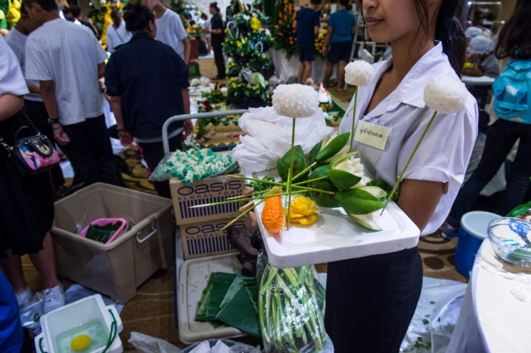 A Thai woman holds a tray with carved fruit and vegetable decorations during a fruit and vegetable carving competition in Bangkok on August 4, 2017. It is a royal tradition that has proved bountiful through the ages and one that Thailand's fruit carvers are determined to keep alive -- even as young people peel away from the unique art form. (ROBERTO SCHMIDT/AFP/Getty Images)