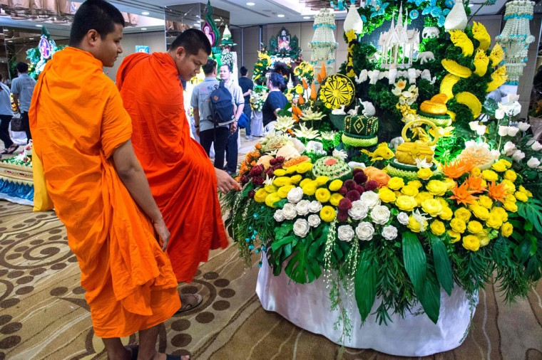 Two Buddhist monks look at an elaborate display of carved fruits and vegetables during a fruit and vegetable carving competition in Bangkok on August 4, 2017. It is a royal tradition that has proved bountiful through the ages and one that Thailand's fruit carvers are determined to keep alive -- even as young people peel away from the unique art form. (ROBERTO SCHMIDT/AFP/Getty Images)