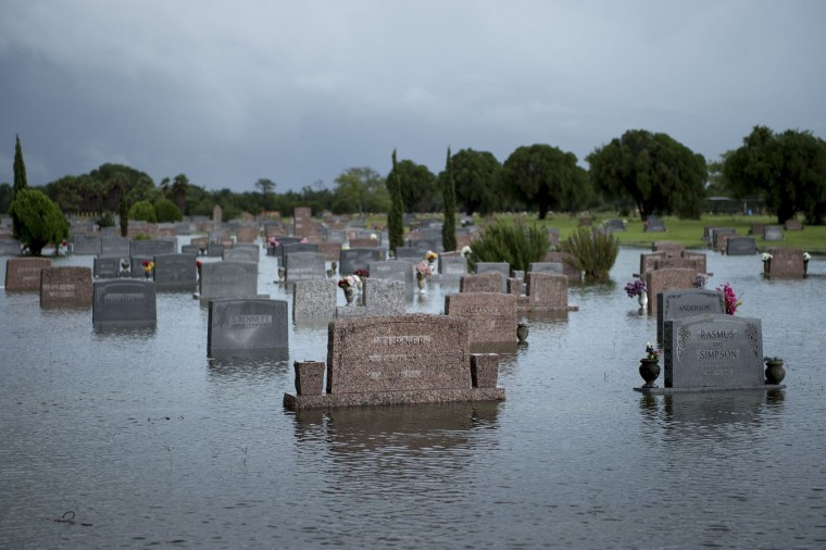 A graveyard is seen as it floods during the aftermath of Hurricane Harvey August 27, 2017 in Pearland, Texas. Hurricane Harvey left a trail of devastation Saturday after the most powerful storm to hit the US mainland in over a decade slammed into Texas, destroying homes, severing power supplies and forcing tens of thousands of residents to flee. (Brendan Smialowski/AFP/Getty Images)