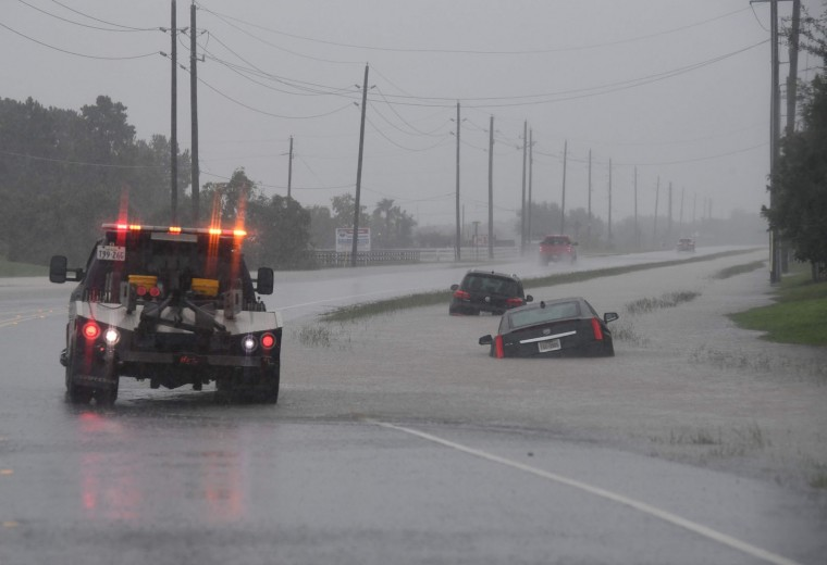 Cars are trapped in floodwater near the I-10 freeway leading into Houston after Hurricane Harvey caused heavy flooding in the city, August 27, 2017. Massive flooding unleashed by deadly monster storm Harvey left Houston -- the fourth-largest city in the United States -- increasingly isolated as its airports and highways shut down and residents fled homes waist-deep in water. (Mark Ralston/AFP/Getty Images)
