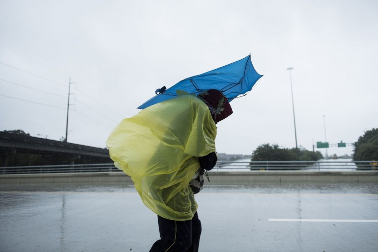 A woman walks through a rain storm during the aftermath of Hurricane Harvey on August 28, 2017 in Houston, Texas. (Brendan Smialowski/AFP/Getty Images)