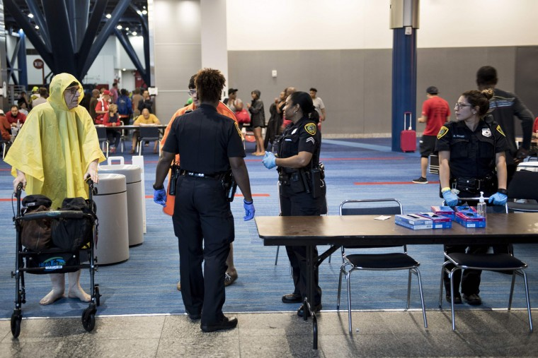 A man leaves a shelter in the George R. Brown Convention Center during the aftermath of Hurricane Harvey on August 28, 2017 in Houston, Texas. (Brendan Smialowski/AFP/Getty Images)
