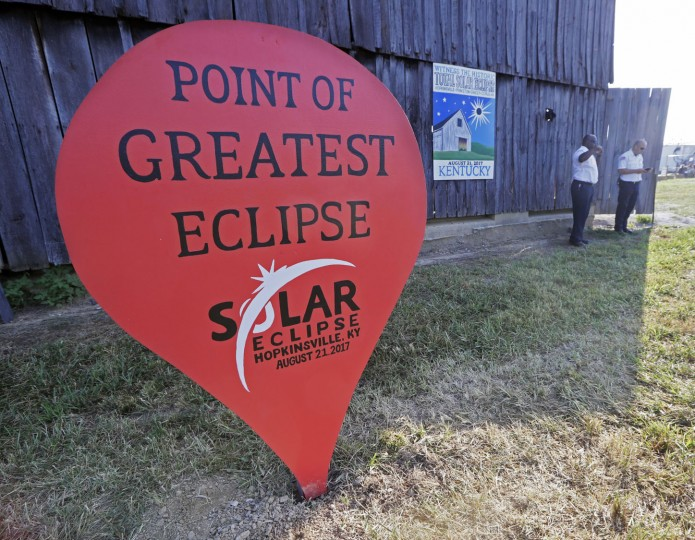 A sign stands at the Orchard Dale historical farm near Hopkinsville, Ky., Monday, Aug. 21, 2017. The location, which is in the path of totality of the solar eclipse, is also at the point of greatest intensity. (AP Photo/Mark Humphrey)