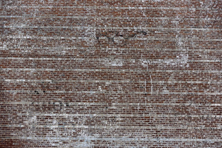 A pair of eyeglasses are barely visible on a wall on Hamilton Ave. (Kim Hairston/Baltimore Sun)