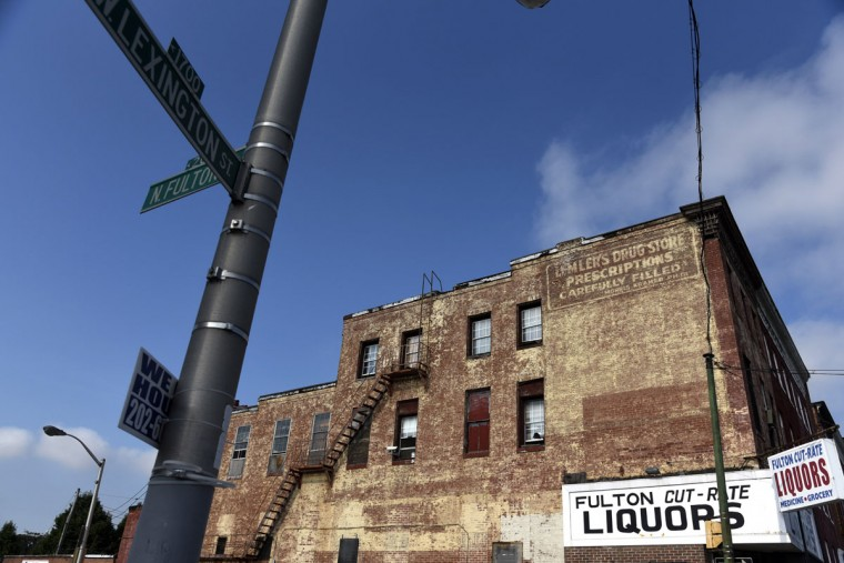 A ghost sign advertising Lemler's Drug Store. The the sign on the liquor store that now occupies the space lists medicine. (Kim Hairston/Baltimore Sun)