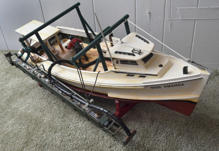 """Norman Gross recreated his cousin Harold Holland's Bay-built, """"Miss Amanda,"""" which Holland built in his barn. It was mostly rigged for clamming. A hose washes the clams as they come up the conveyor belt, working almost like a dredger. (Amy Davis / The Baltimore Sun)"""