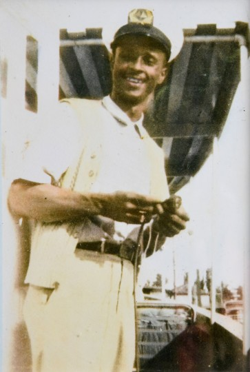 Norman Gross keeps this photo of his father, Frank Gross, one of the first African-American captains on the Chesapeake, on display with the model boats he has created to honor his father and an earlier generation of African-American Chesapeake Bay watermen. (Photo Courtesy of Norman Gross)