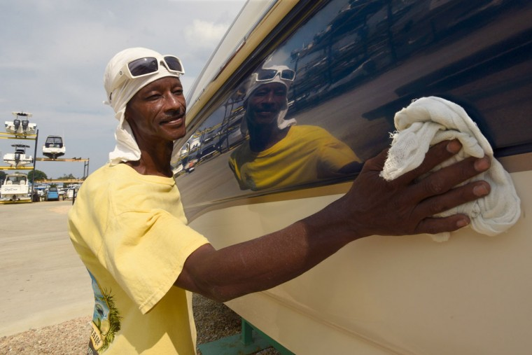 Norman Gross, 58, is a skilled gelcoat and fiberglass technician, but is also called upon for other tasks at South River Marina, such as applying compound to polish a boat hull. Gross builds model boats that pay homage to an earlier generation of African-American watermen on the Chesapeake. (Amy Davis / The Baltimore Sun)