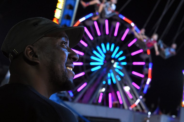 Clay Gordon of Baltimore watches his children on the YoYo swing. (Lloyd Fox/Baltimore Sun)