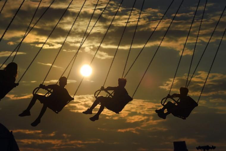 Fair goers enjoy a ride on the Yoyo swing as the sun sets for the evening. (Lloyd Fox/Baltimore Sun)