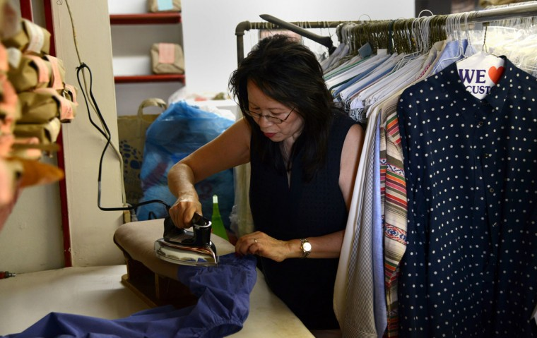 Shirley Tsao, whose family owns TC Wing Laundry in Roland Park, irons a blouse. They are the city's last remaining Chinese hand laundry. (Barbara Haddock Taylor/Baltimore Sun)