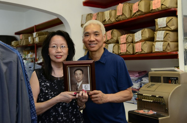 Ricky Tsao, right, and his wife Shirley, left, hold a photograph of his grandfather, Chak Wing Tsao, in the family's T.C. Wing Chinese Hand Laundry. His grandfather, who died in 1995, started the business in 1932. Ricky and his wife Shirley have been carrying on the tradition for the last 40 years.