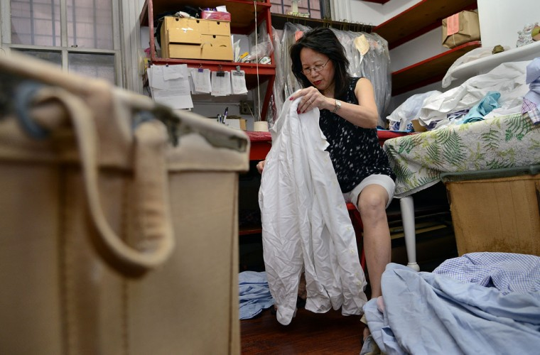 Shirley Tsao sorts garments in her family's business, the T.C. Wing Chinese Hand Laundry in Roland Park, which was started by her husband's grandfather in 1932.