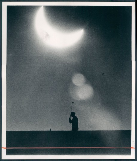 1972: A Clifton Park golfer plays through yesterday's partial solar eclipse about 4pm. (Swagger/Baltimore Sun archives)