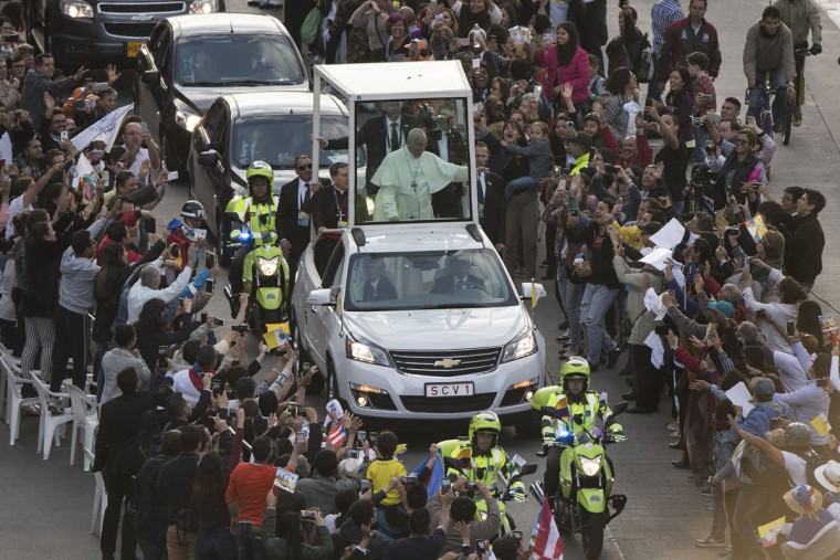 Pope Francis rides on the Popemobile on his way to the Nunciature after his arrival to Bogota. AFP PHOTO / PEDRO UGARTE