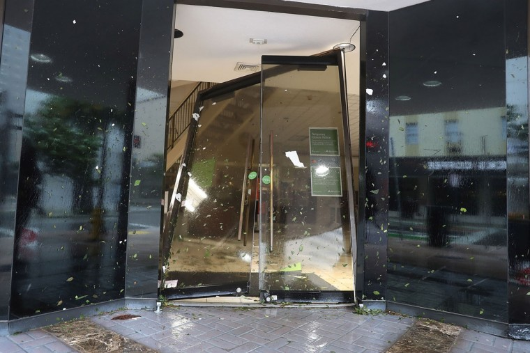MIAMI, FL - SEPTEMBER 10: A door is seen blown in at a Regions Bank as Hurricane Irma passes through on September 10, 2017 in Miami, Florida. Hurricane Irma made landfall in the Florida Keys as a Category 4 storm on Sunday, lashing the state with 130 mph winds as it moves up the coast. (Photo by Joe Raedle/Getty Images)