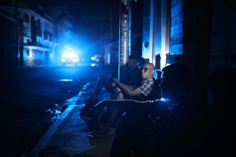 SAN JUAN, PUERTO RICO - SEPTEMBER 23: Jaime Degraff sits outside as he tries to stay cool as people wait for the damaged electrical grid to be fixed after Hurricane Maria passed through the area on September 23, 2017 in San Juan, Puerto Rico. Puerto Rico experienced widespread damage after Hurricane Maria, a category 4 hurricane, passed through. (Photo by Joe Raedle/Getty Images)