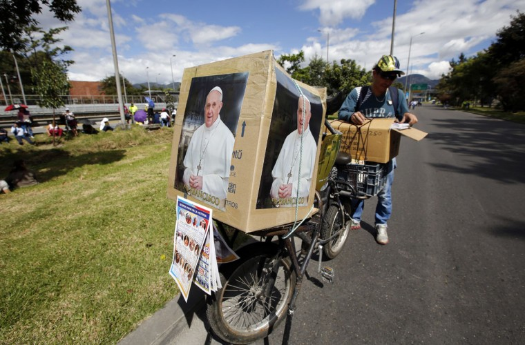 A man sells pictures and other souvenirs related to Pope Francis. (AP Photo/Fernando Vergara)