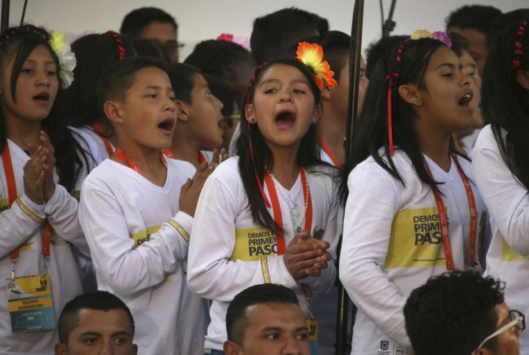 Children sing in honor of Pope Francis as the pontiff arrives to the Nunciature in Bogota, Colombia. (AP Photo/Ivan Valencia)