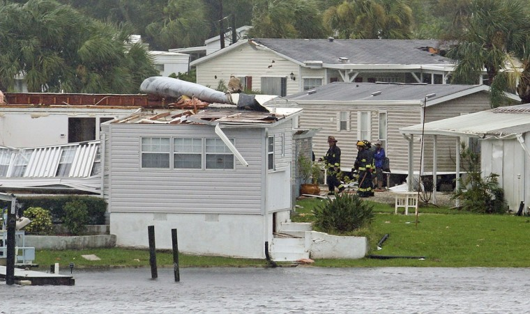 Palm Bay fire fighters go house to house after a possible tornado touched down at Palm Palm Bay Estates Sunday, Sept. 10, 2017 as Hurricane Irma made landfall in the state of Florida. (Red Huber/Orlando Sentinel via AP)