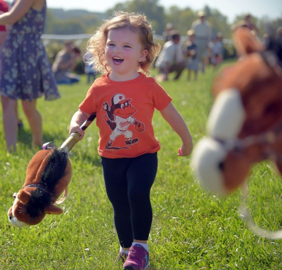 Elise Reagan, 2-1/2 of Upperco, MD participates in the toddlers' stick horse race during the 2017 Legacy Chase at Shawan Downs. (Karl Merton Ferron / Baltimore Sun Staff)