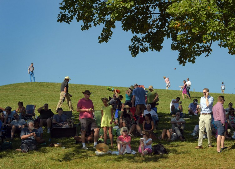 People use shade at the picnic area to enjoy the afternoon during the 2017 Legacy Chase at Shawan Downs. (Karl Merton Ferron / Baltimore Sun Staff)