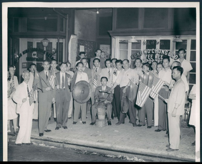 August 16, 1945-JAPANESE SURRENDER--Chinese VJ-Day celebration at 312 Park Avenue in front of the Kung Wo Chong & Company building. Photo by Sun photographer.