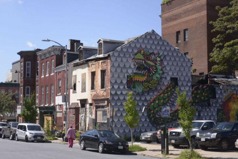 On the side of a derelict building on Park Avenue, a mural by Annapolis-based artist Jeff Huntington pays tribute to Baltimore's historic Chinatown as well as its growing Ethiopian community. (Christina Tkacik/Baltimore Sun)