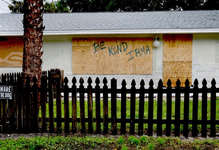 A homeowner in Bonita Springs, Florida, makes a plea to Hurricane Irma. (Washington Post photo by Michael S. Williamson)