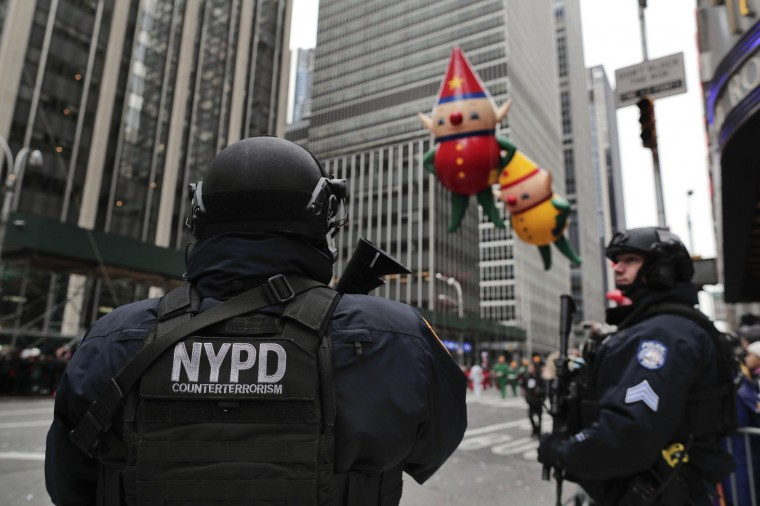 FILE - In this Nov. 24, 2016, file photo, New York Police counterterrorism personnel watch as the Macy's Thanksgiving Day parade makes its way down Sixth Avenue in New York. After the deadly truck attack in Manhattan on Oct. 31, 2017, every intersection along the 2 1/2-mile parade route that stretches from Central Park to the Macy's flagship store on 34th Street will be blocked to traffic. (AP Photo/Julie Jacobson, File)