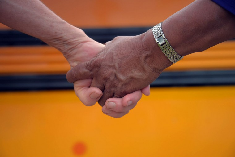 Participants hold hands during the second Baltimore Cease Fire weekend, held at Edmondson Village Shopping Center. (Karl Merton Ferron / Baltimore Sun Staff)