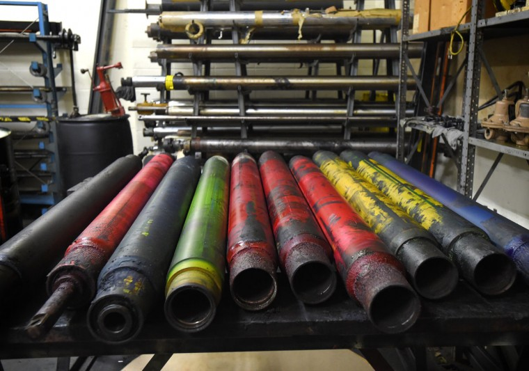 Color ink rollers from the press that have been replaced after several million impressions. The facility uses 26,000 gallons of black ink per year to print the paper. Enough to fill one Olympic-size swimming pool. (Lloyd Fox/Baltimore Sun)