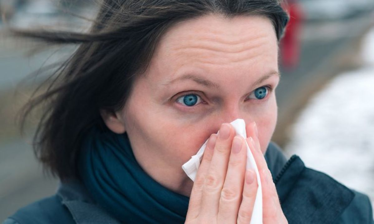 woman-eyes-wide-open-holding-tissue-to-nose-768.jpg