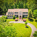 Gorgeous updated colonial in a prestige acreage estate